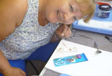 Students learn how to fuse glass on a kiln forming taster day