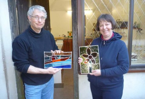 Two happy students learn to make copper foiled stained glass on a two day copper foil stained glass course in Kent