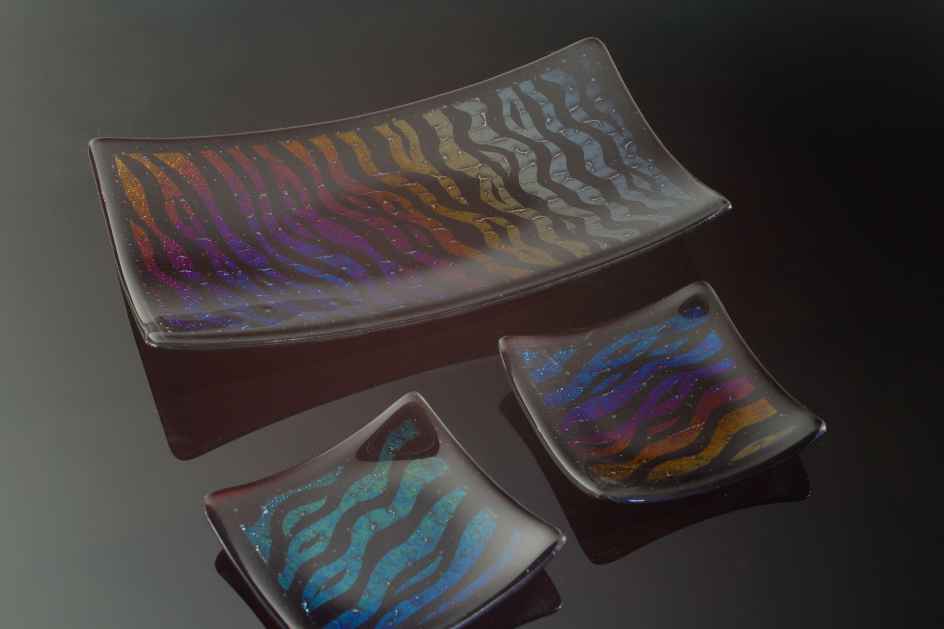 This fused glass platter and small glass dishes are an example of what you can make using glass fusing techniques.