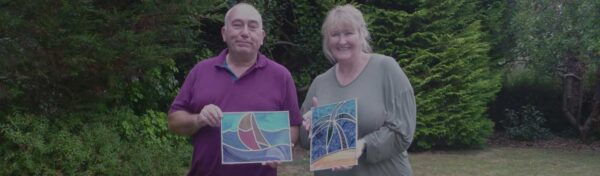 Leaded stained glass panels made on a two day course - a palm tree and a sailing boat