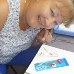 a student having a good time making fused glass on a glass fusing day course