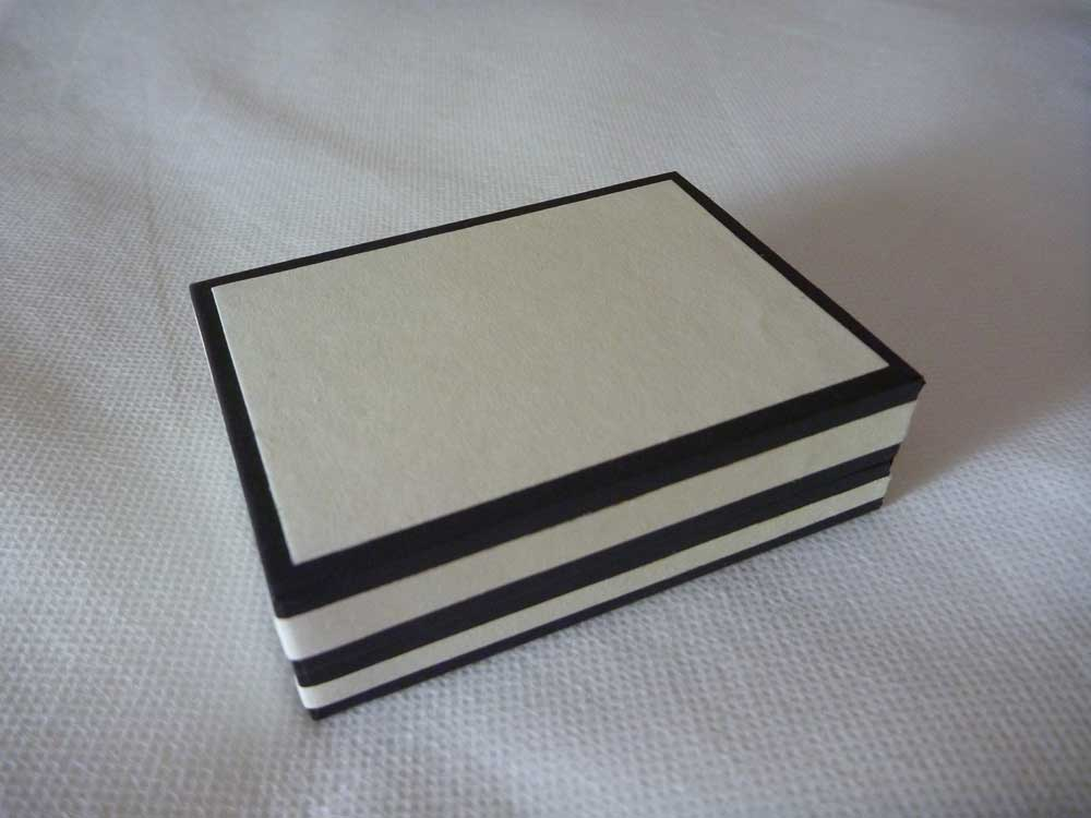 soft white and black luxury jewellery box with black velvet and satin inside