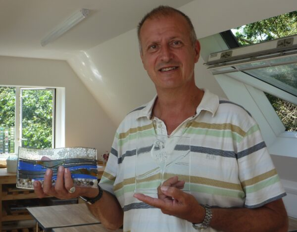 A happy customer collects his creations after his glass fusion class in Kent, near Ashfords
