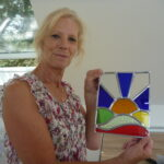 A happy customer shows off the stained glass panel that she's made on our 2 day creative glass course in Kent