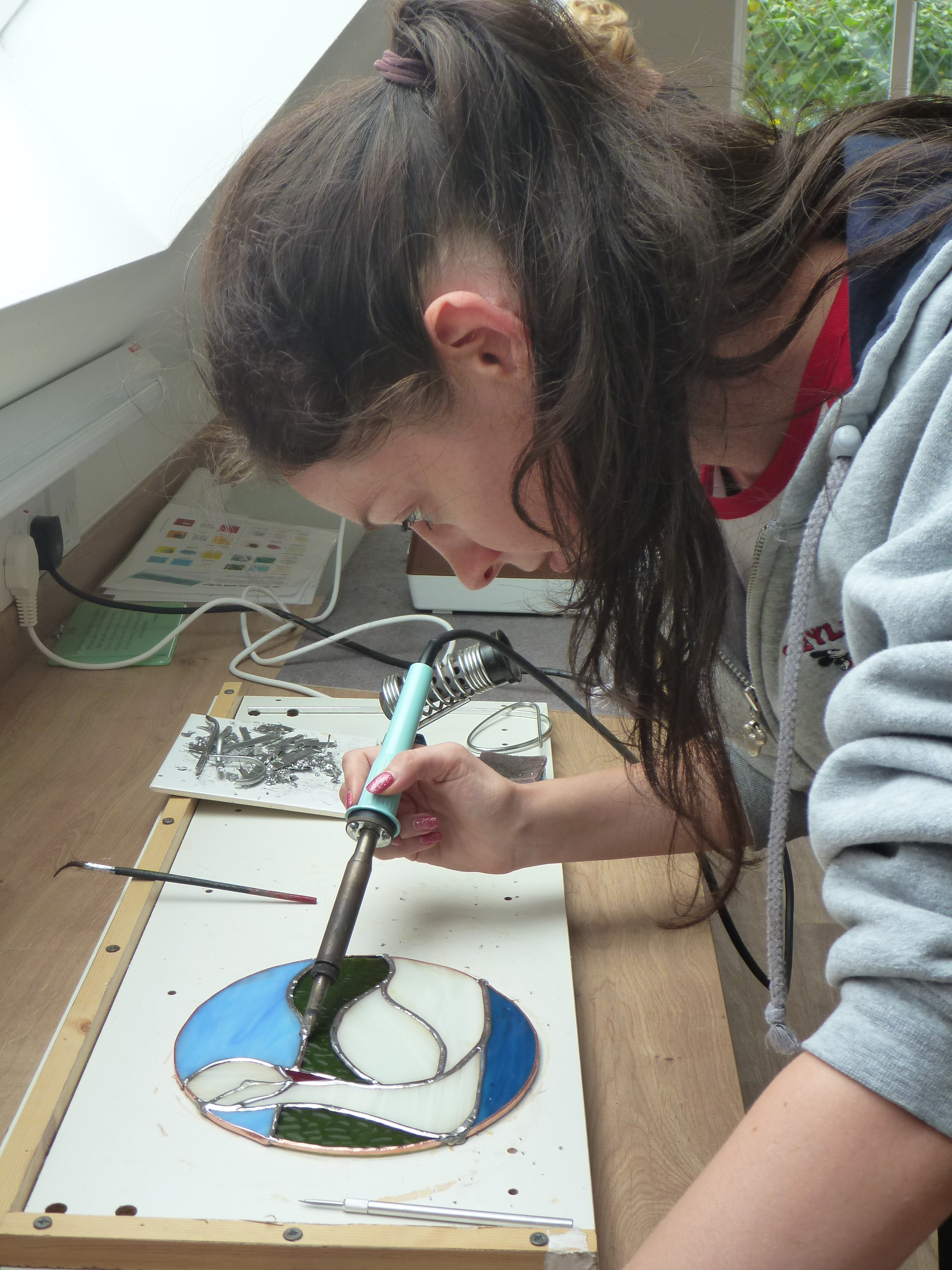 Soldering a copper foiled Tiffany swan copper light together