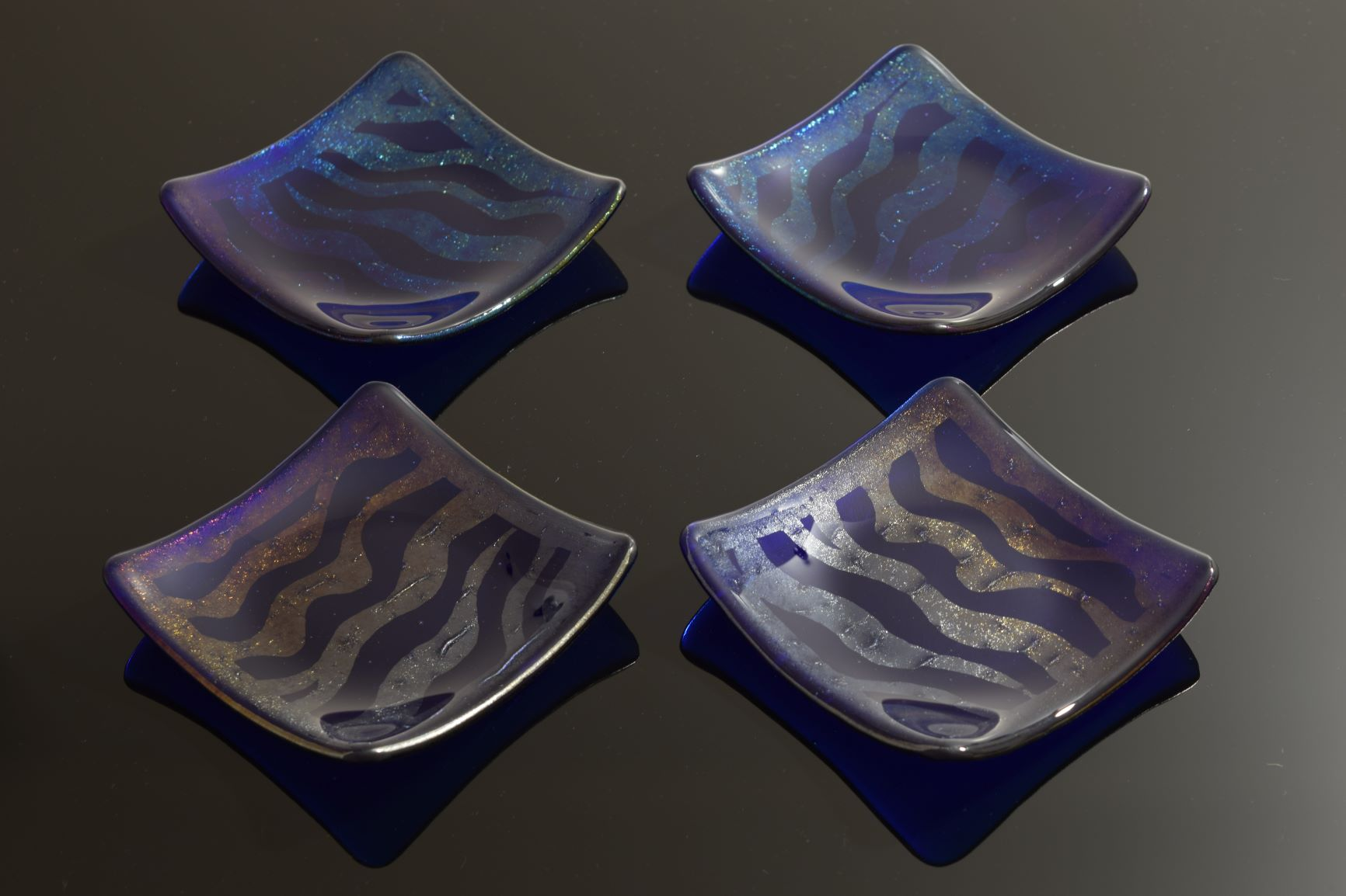 Set of 4 fused galss Strata dishes in royal blue transparent glass. Photo © M.Wilson