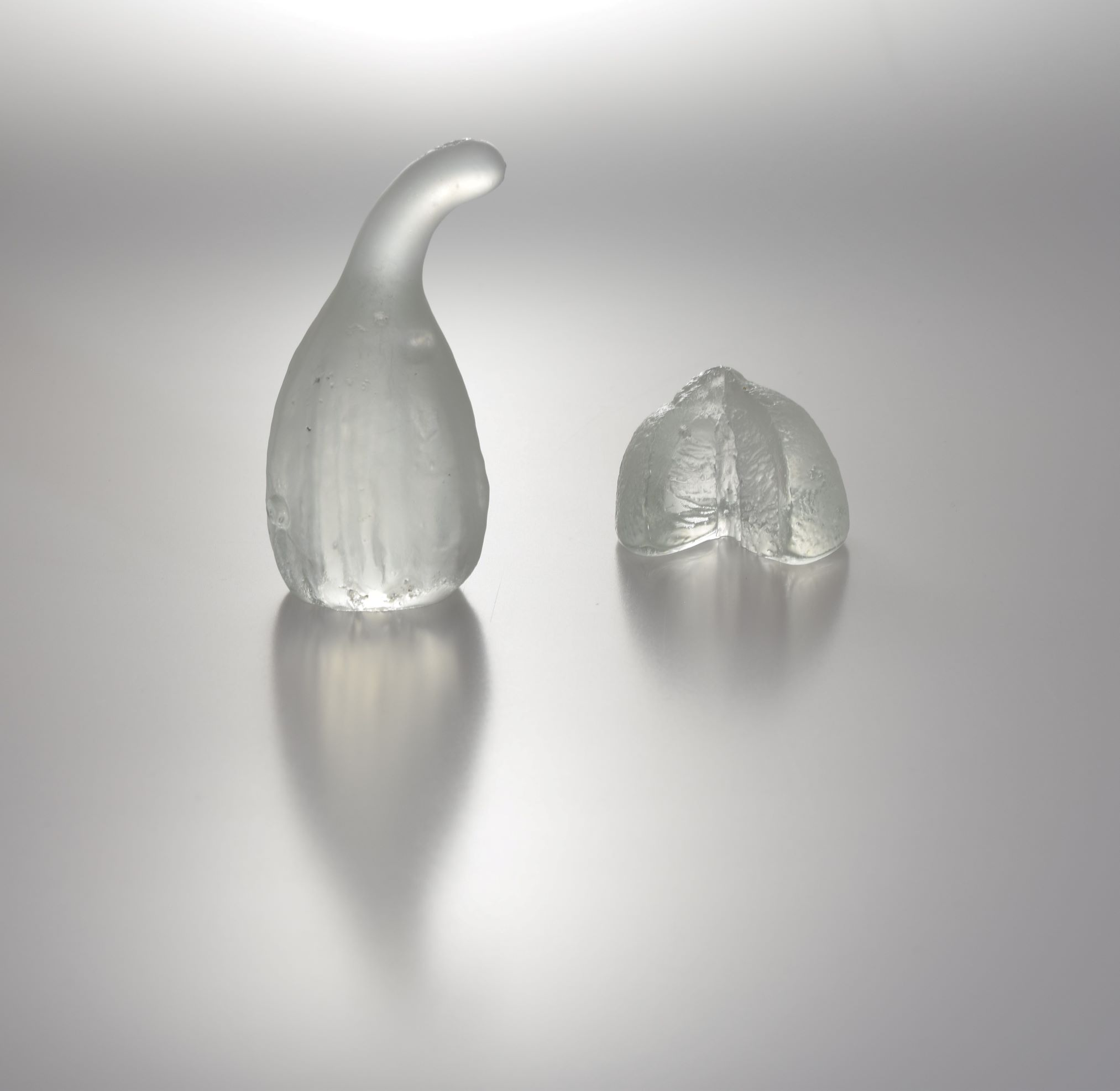 cast glass gourd (on the left) and cast glass lime (on the right), each available to buy separately