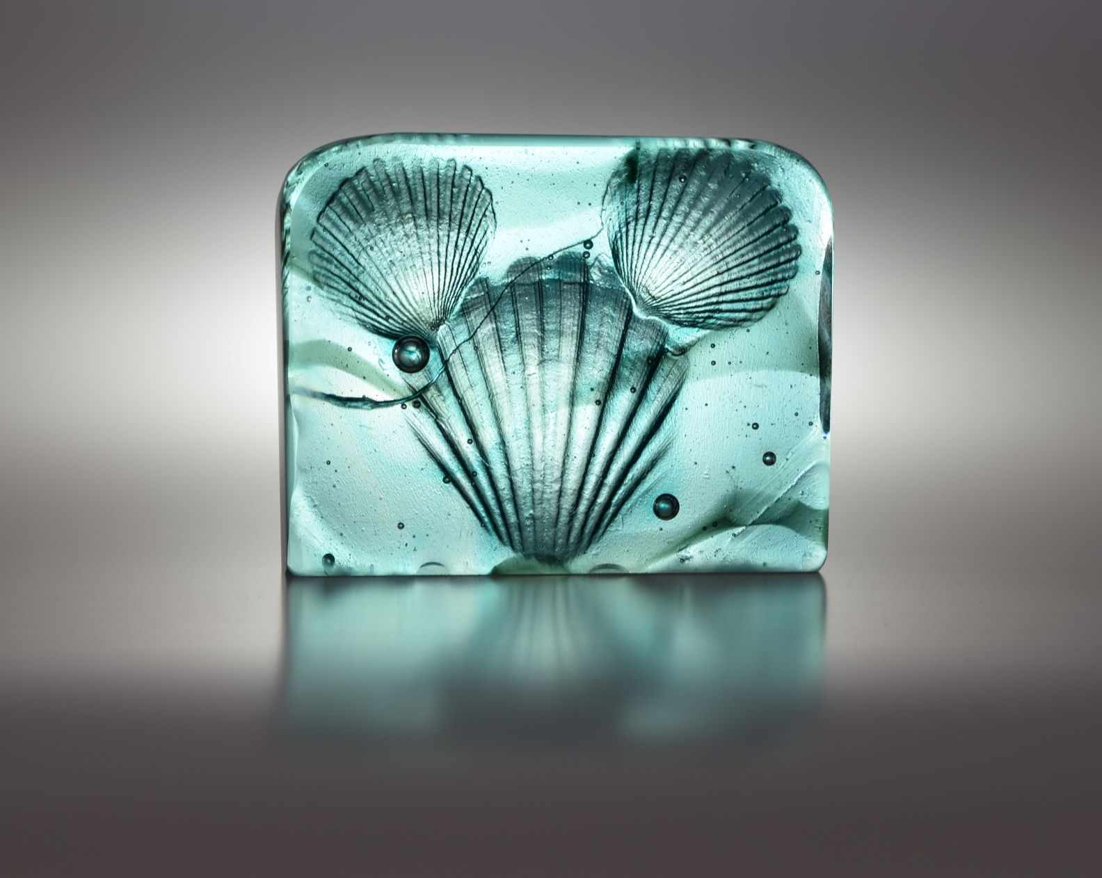 cast glass sculpture of shells, pearls and ocean waves