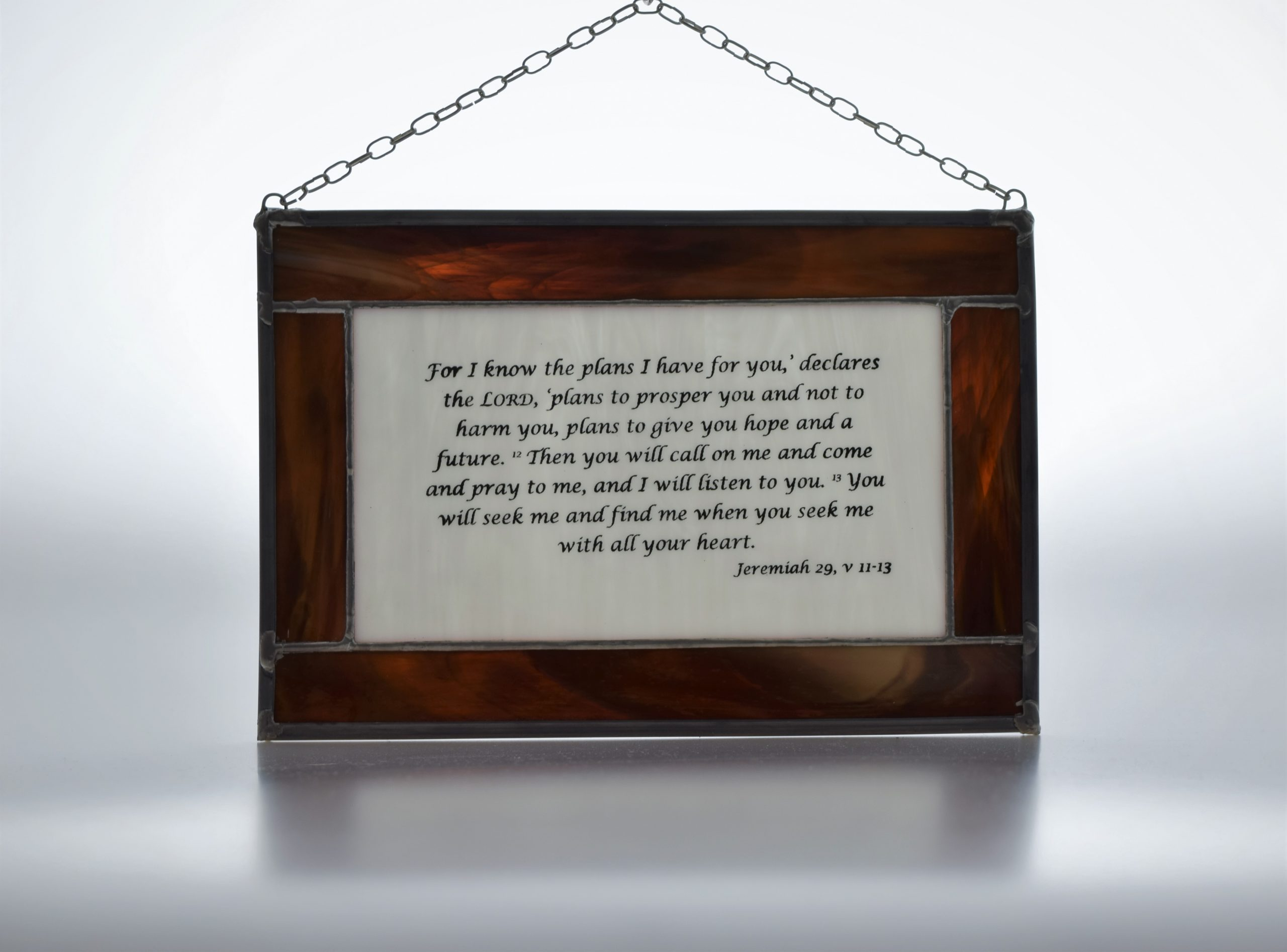 "Copper foiled panel with lead surround featuring ""For I know the plans I have for you"" bible quote"