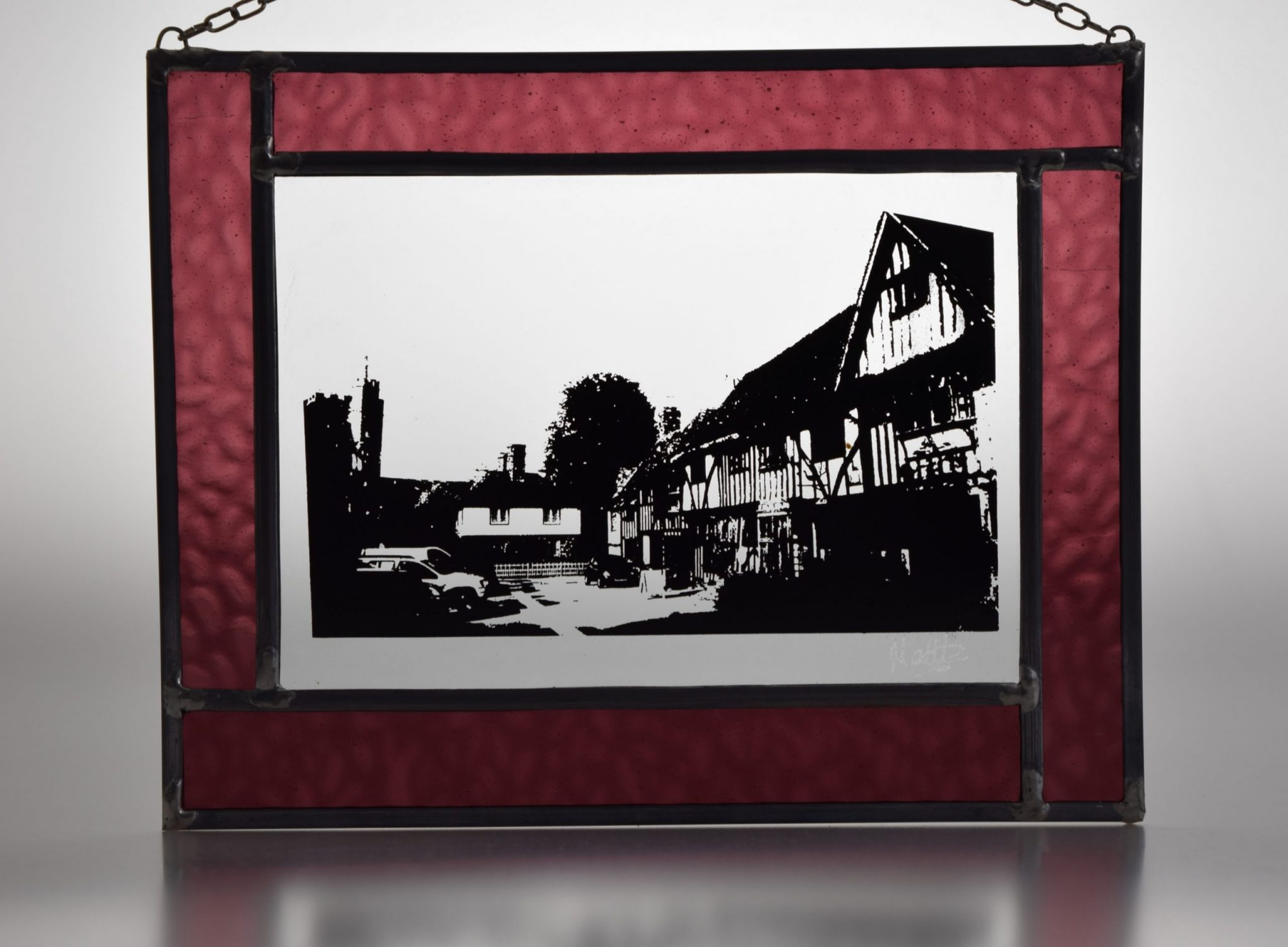 Stained glass picture of Chilham medieval village in Kent