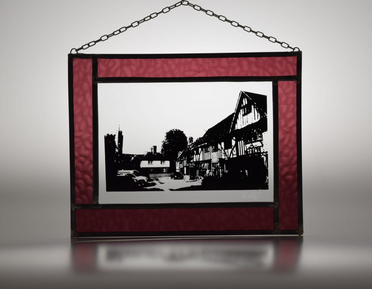 Historical Chilham captured in a traditional stained glass panel, available to buy