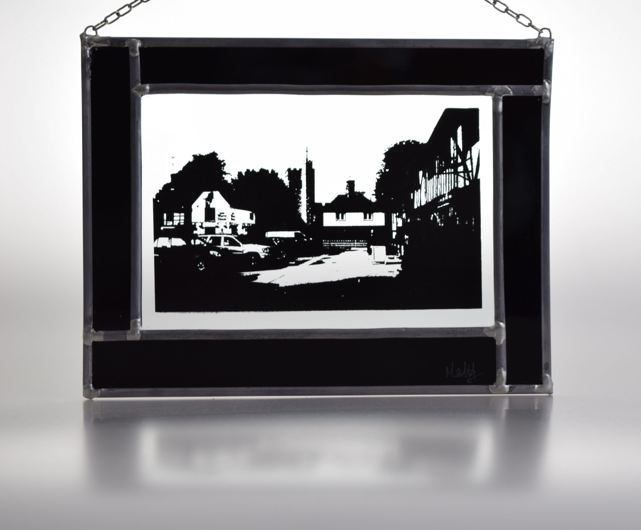 View of Chilham village square captured in a stained glass panel