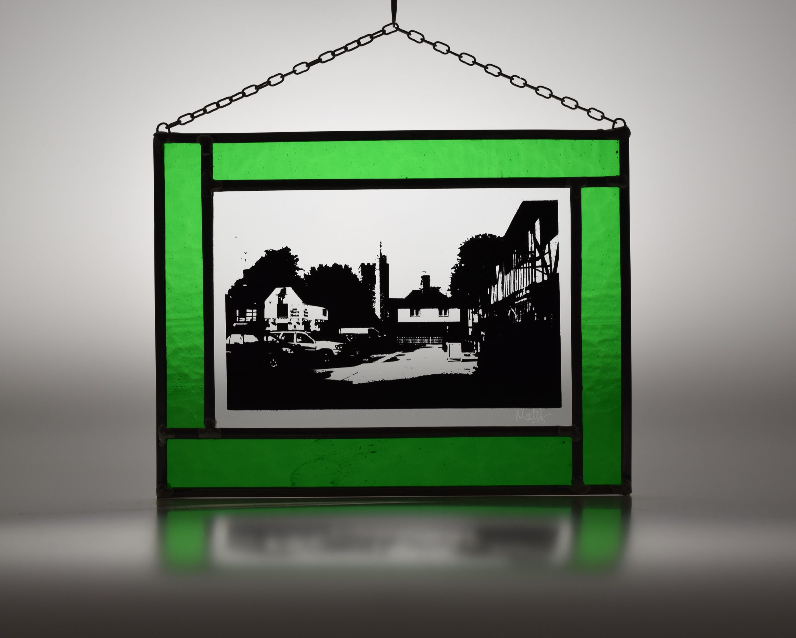 Chilham stained glass panel with green glass frame