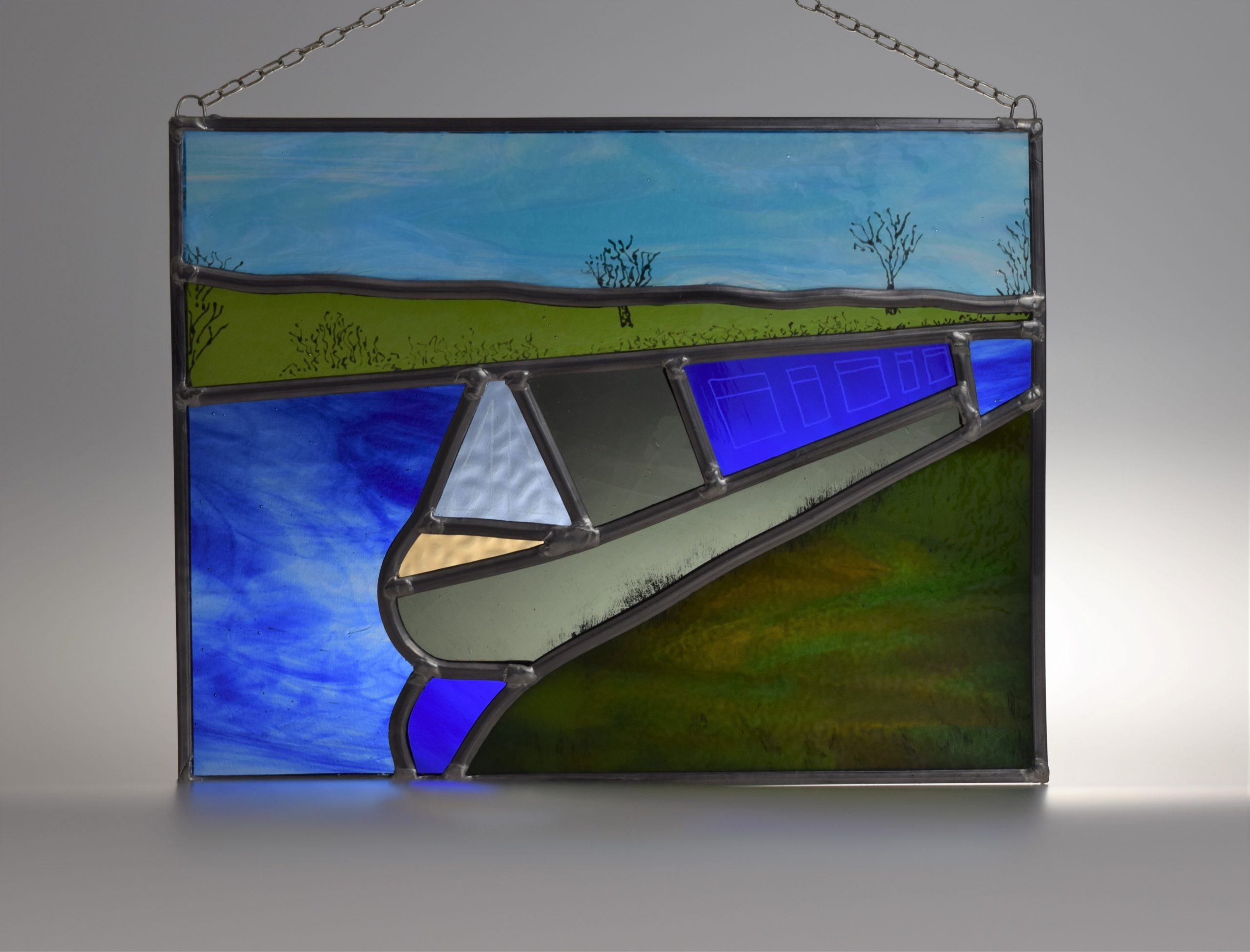 Peaceful daytime mooring on the riverbank in Cheshire - canal boat stained glass panel