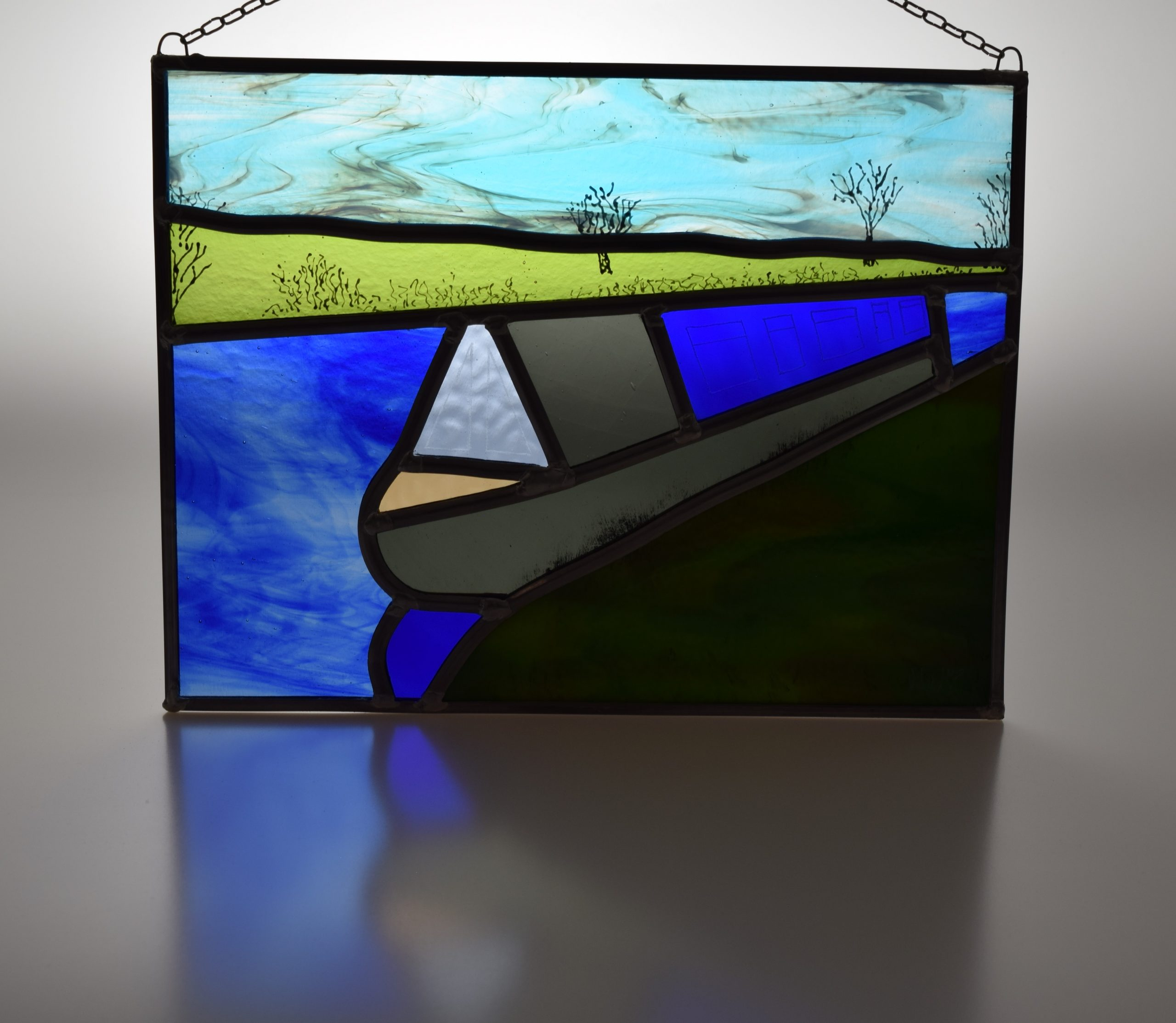 A canalboat moored on the RIver Weaver in Cheshire, captured in stained glass