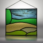 A simple stained glass panel (leaded light) showing the Kent Downs landscape