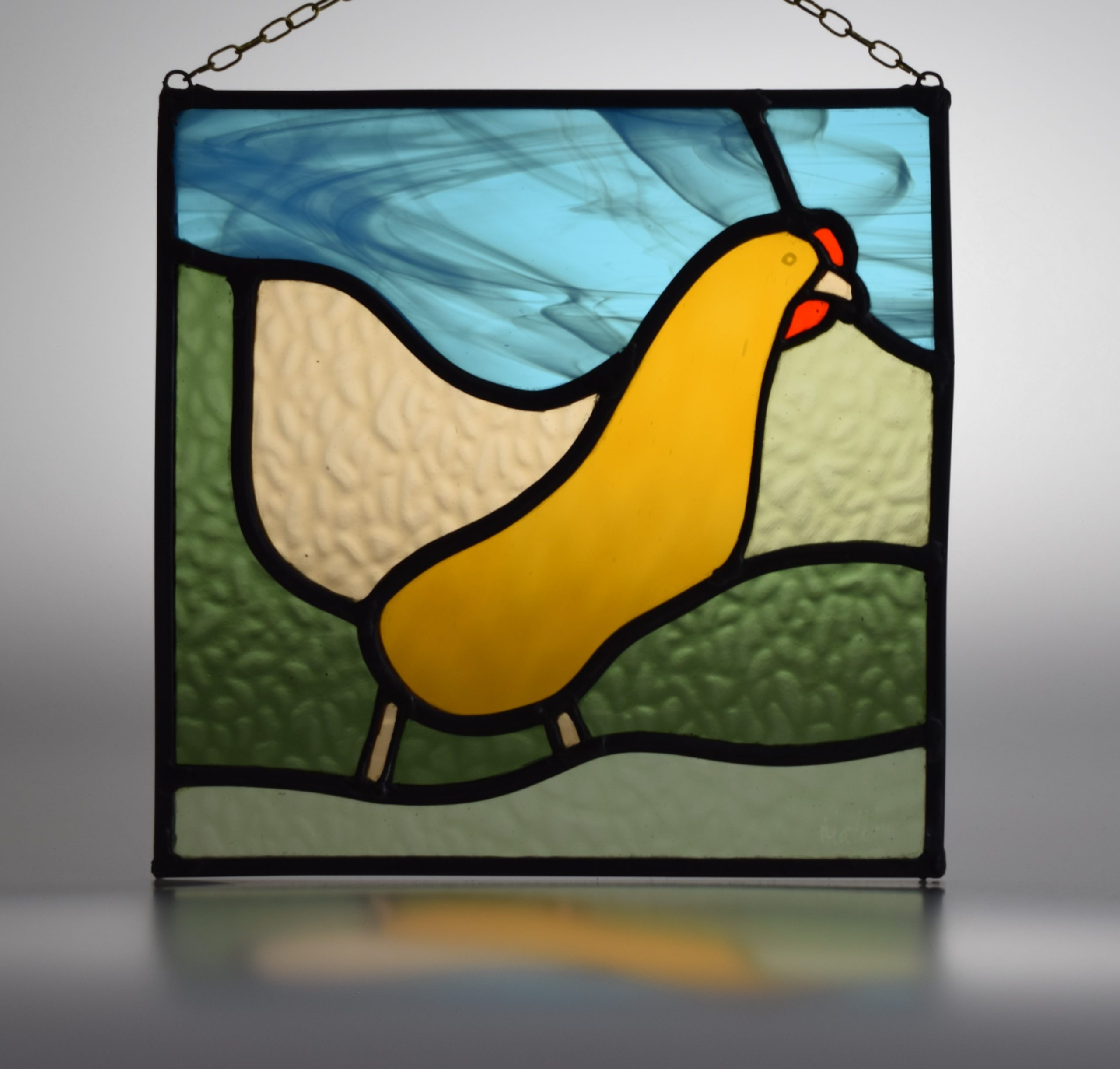 Stained glass ex-battery hen now enjoying life as a stained glass panel!