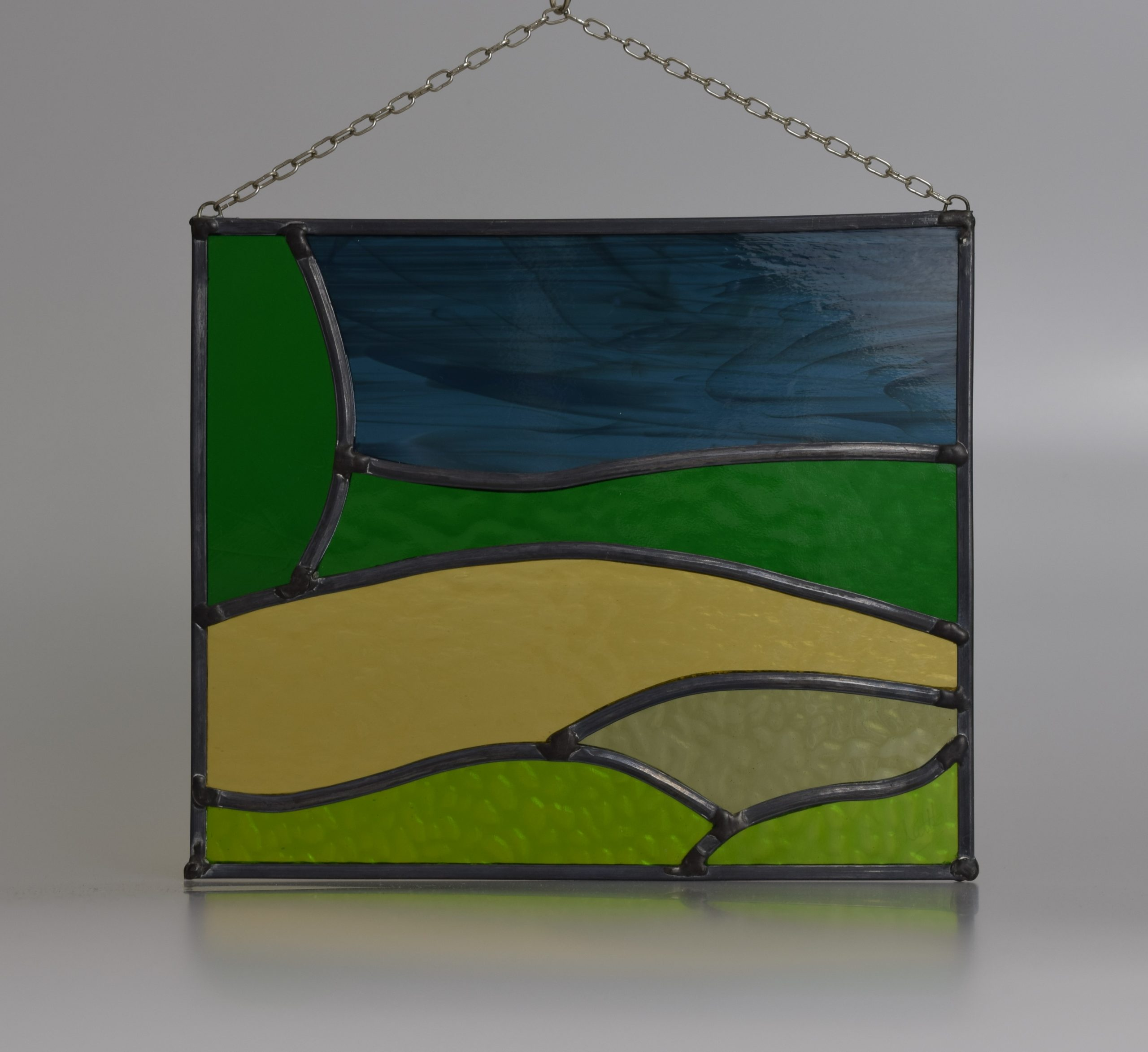 Stained glass panel of a view across the Kent Downs AONB