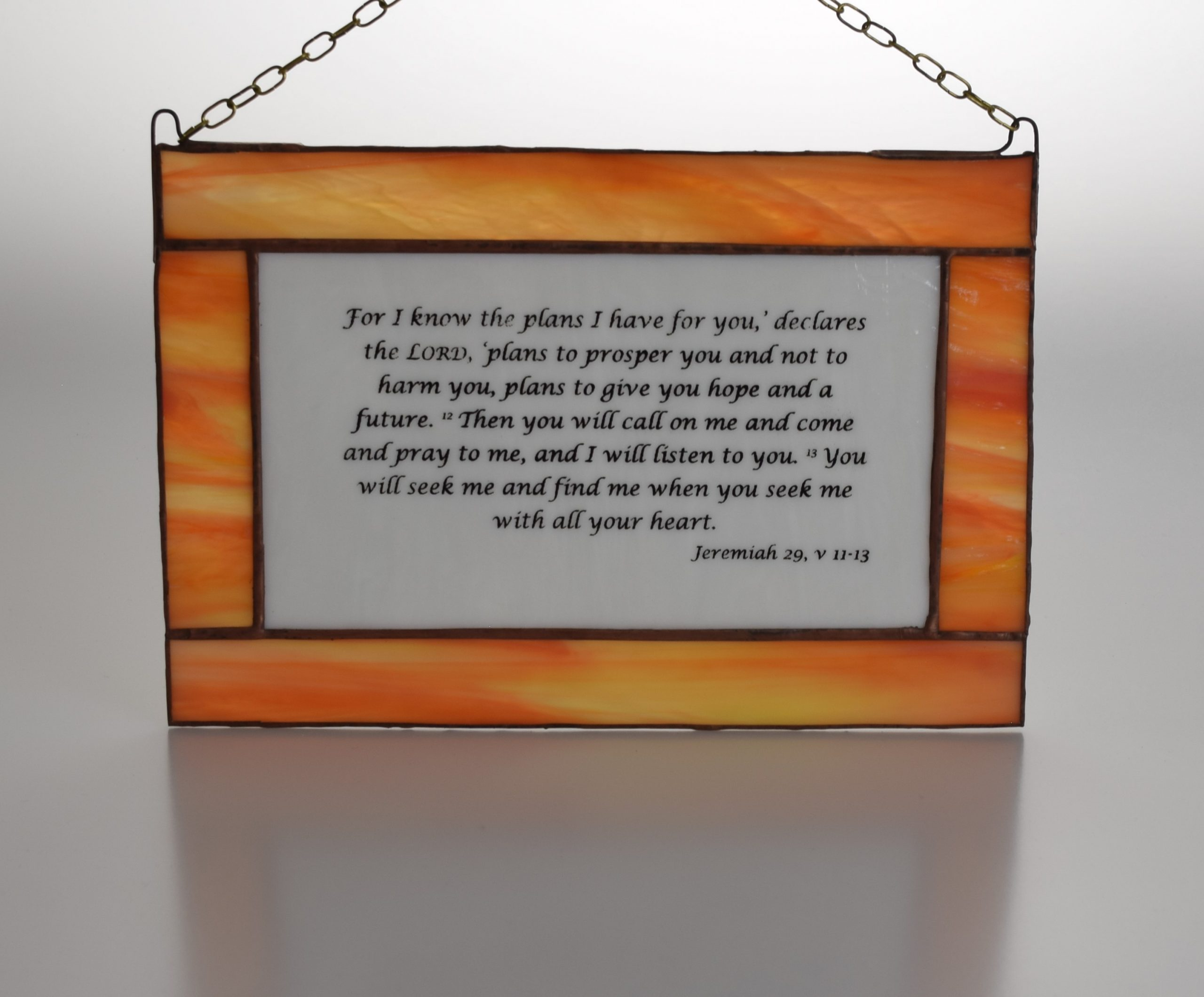 Jeremiah 29, v 11-13 stained glass panel with black script on white glass and an attractive orange surround