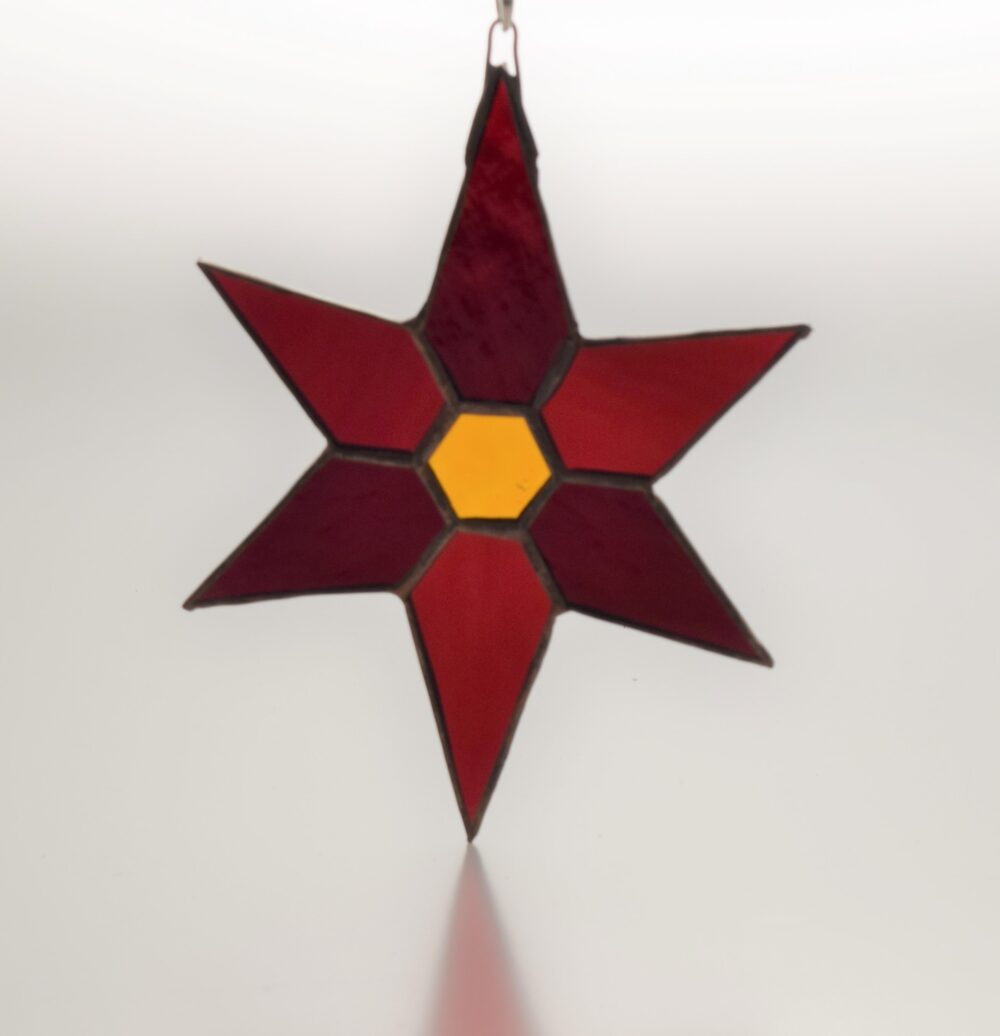 Decorate your house with this red and gold glass star made using the copper foil techninque of stained glass