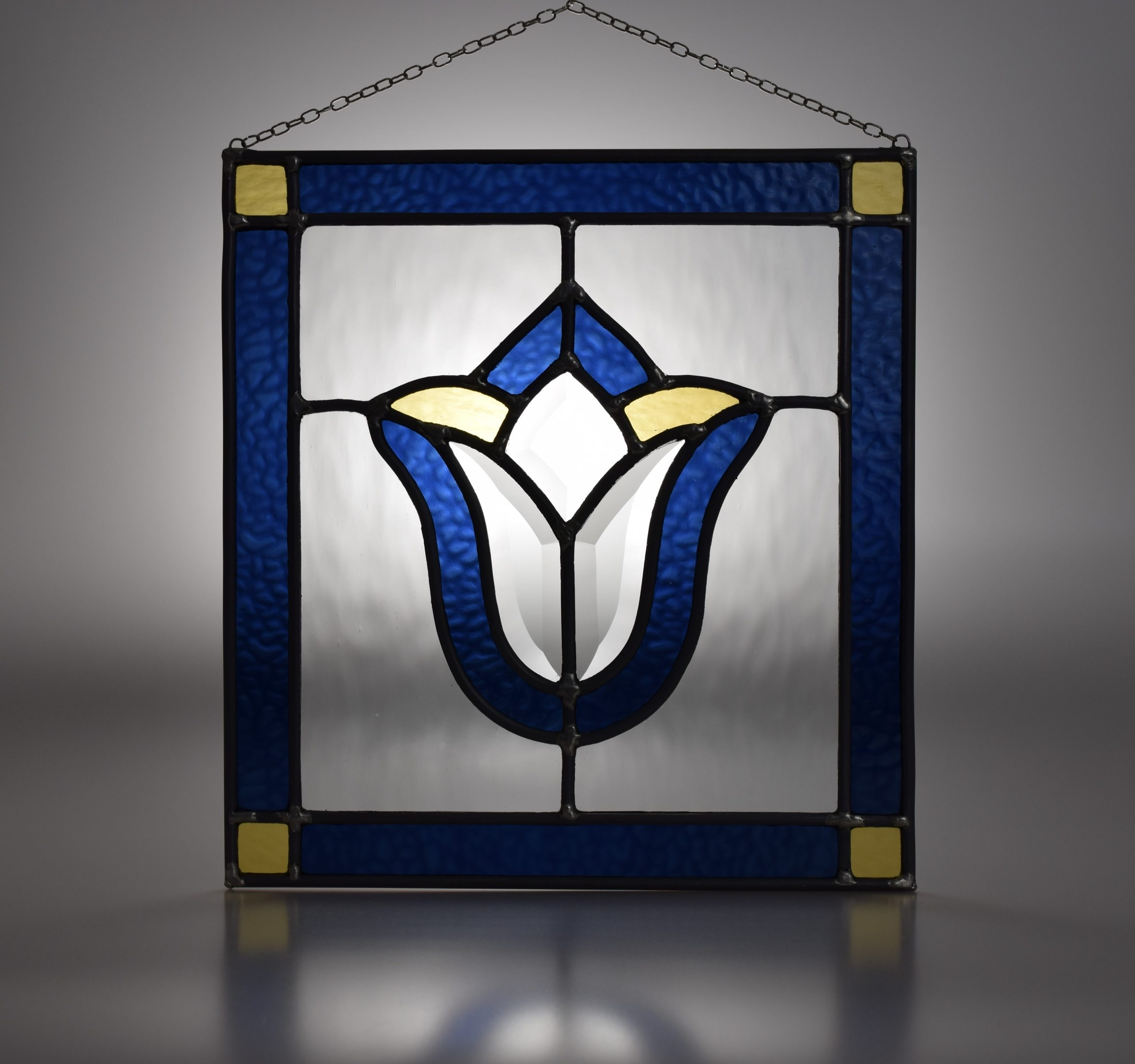 """Traditional leaded stained glass panel with classic """"tulip"""" design in French navy, pale yellow and colourless textured glass"""