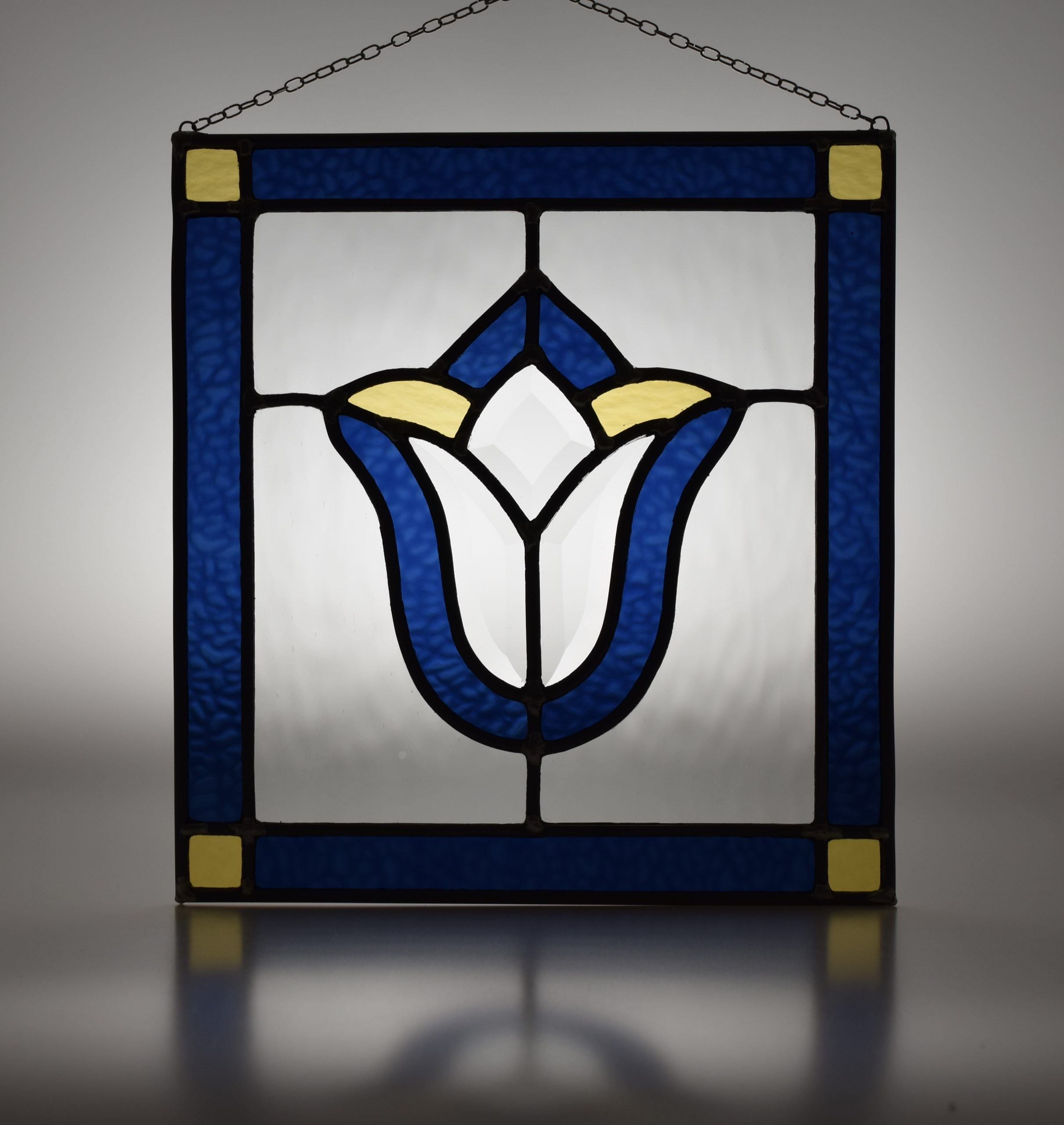 Blue, clear and straw yellow leaded stained glass panel