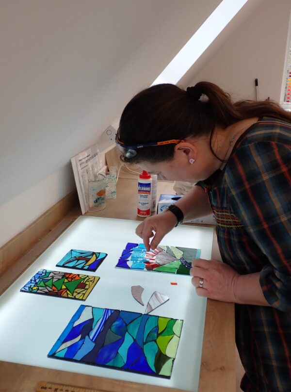 stained glass mosaic workshop - here a panel is being designed on a lightbox in our Chilham glass studio