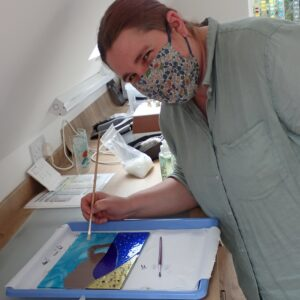 Following on from a first day of glass fusing, an improver student makes a lovely glass picture of Durdle Door in Dorset